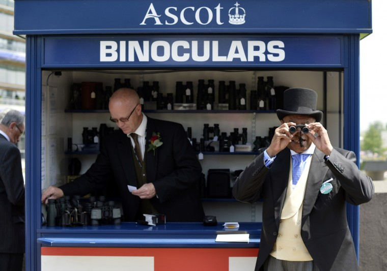 Ed Bethel, High Commisioner for the Commonwealth of The Bahamas, tries a pair of binoculars during the second day of Royal Ascot, in Berkshire, west of London. (Adrian Dennis/Getty images)