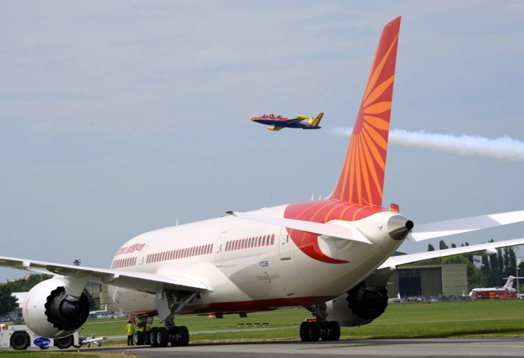 A Fouga Magister flies over an Air India Boeing Dreamliner on Le Bourget airport, near Paris on June 19, 2013 during the 50th International Paris Air show. (Eric Feferberg/Getty Images)