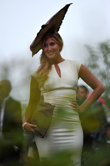A woman poses for a photograph during the third day of Royal Ascot, in Berkshire, west of London. (Carl Court/Getty images)