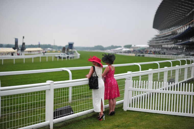 Women view the course before races begin on the third day of Royal Ascot, in Berkshire, west of London. (Carl Court/Getty images)