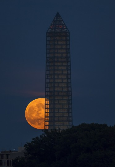 This photo provided by NASA shows a supermoon rises behind the Washington Monument in Washington. (Bill Ingalls/NASA)