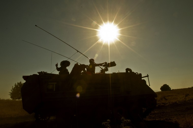 An Israeli army Armored Personnel Carrier (APC) maneuvers during a military exercise near the northern border with Syria in the Israeli-annexed Golan Heights. (Jack Guez/Getty Images)