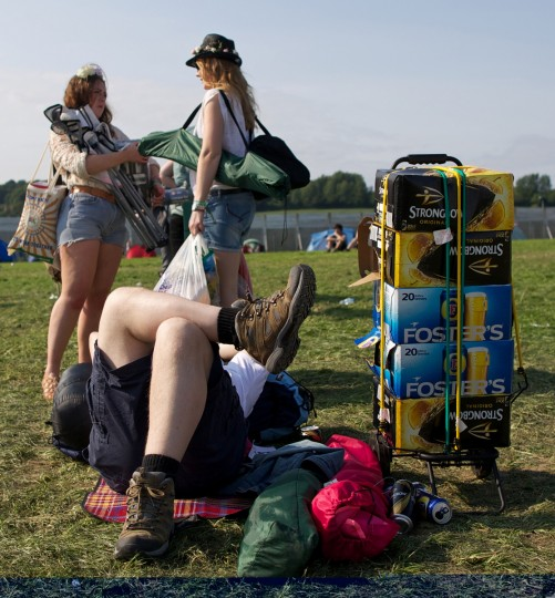 Festivalgoers relax in the evening sunshine on the first day of the Glastonbury Festival of Contemporary Performing Arts near Glastonbury, southwest England on June 26, 2013. The festival attracts 170,000 party-goers to the dairy farm in Somerset, and this year's tickets sold out within two hours of going on sale. The Rolling Stones will perform at the festival for the first time, headlining on Saturday night. (Andrew Cowie/Getty Images)