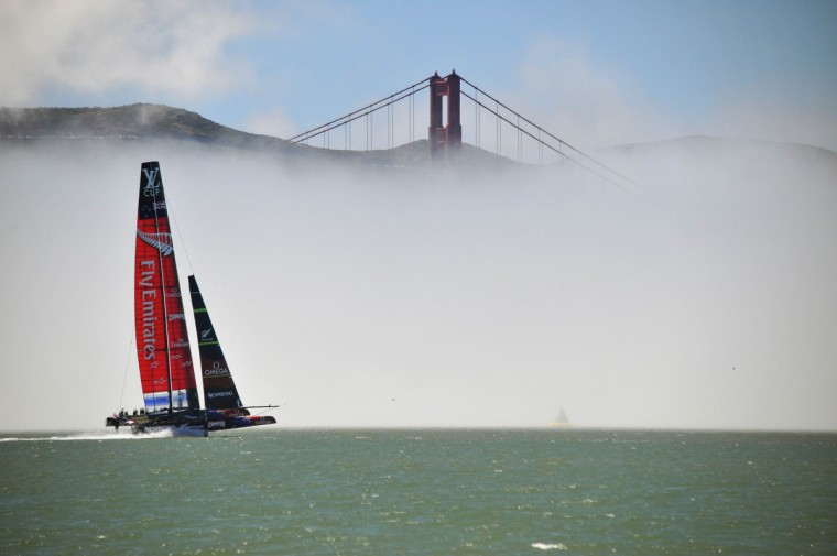 Team Emirates sails their AC-72 Racing Yacht by the Golden Gate Bridge as they test out the course in preparation for the upcoming America's Cup competition on the San Francisco Bay in San Francisco, California. (Josh Edelson/AFP/Getty Images)