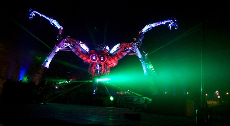 A mechanical spider moves around the site on the first night of the Glastonbury Festival of Contemporary Performing Arts near Glastonbury, southwest England late on June 26, 2013. (Andrew Cowie/Getty Images)