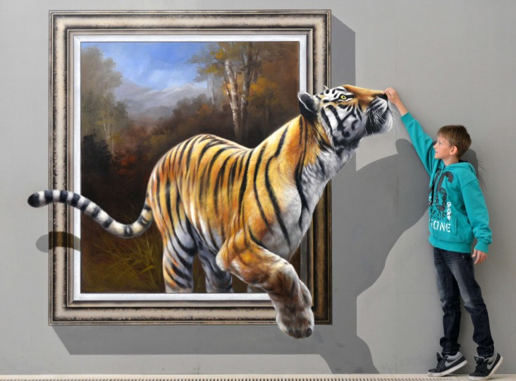 "Dustin poses next to an art work depicting a tiger and created in a special 3D-technique by a Chinese-Korean artist group at the exhibition ""Du bist die Kunst!"" (You are the Art!) at Augustusburg Palace in Augustusburg near Chemnitz, eastern Germany. (Hendrik Schmidt/Getty images)"