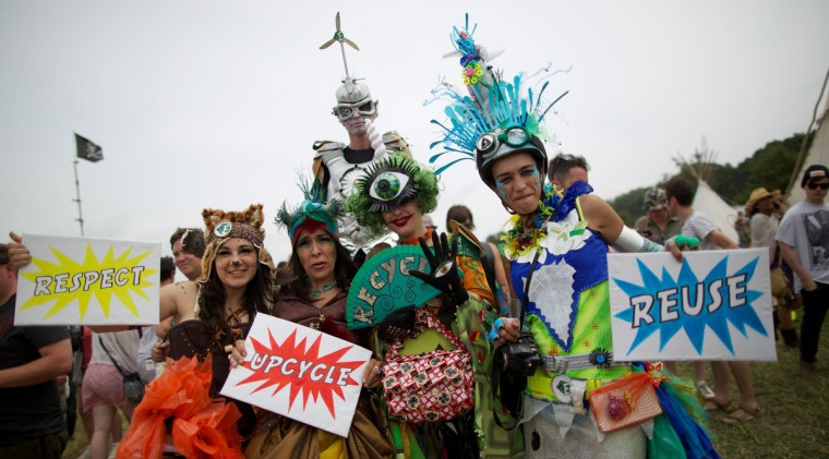 Festival goers in costume pose for photographs on the second day of the Glastonbury Festival of Contemporary Performing Arts near Glastonbury, southwest England on June 27, 2013. (Andrew Cowie/Getty Images)