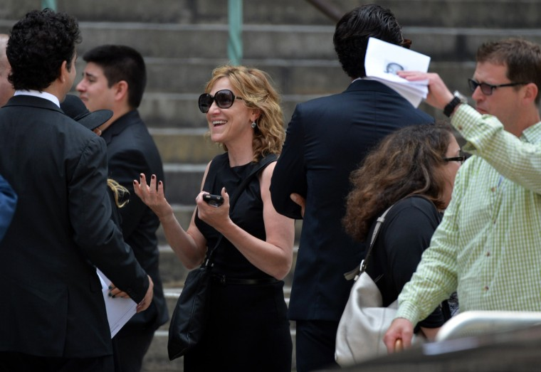 """Actress Edith """"Edie"""" Falco, best known as Carmela Soprano in The Sopranos, departs the Cathedral Church of St. John the Divine after the funeral service for """"Sopranos"""" actor James Gandolfini on June 27, 2013 in New York. (Stan Honda/Getty Images)"""