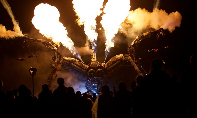 The Arcadia giant metal spider and dancers perform to music on the second day of the Glastonbury Festival of Contemporary Performing Arts near Glastonbury, southwest England, on June 27, 2013. (Andrew Cowie/Getty Images)