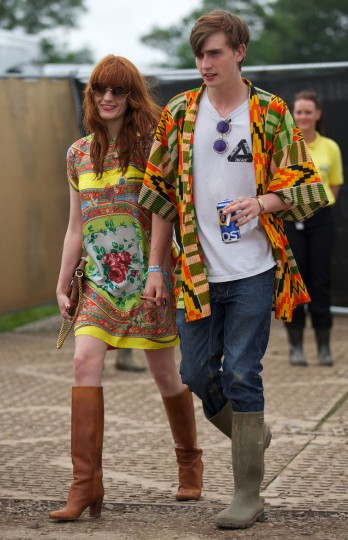 British singer Florence Welch (L) walks through the back stage on the third day of the Glastonbury Festival of Contemporary Performing Arts near Glastonbury, southwest England, on June 28, 2013. (Andrew Cowie/Getty Images)