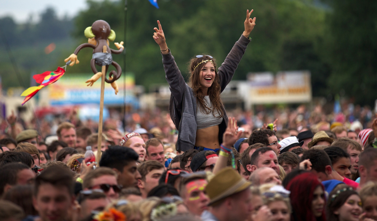 Festival goers attend concerts at the Pyramid Stage during the third