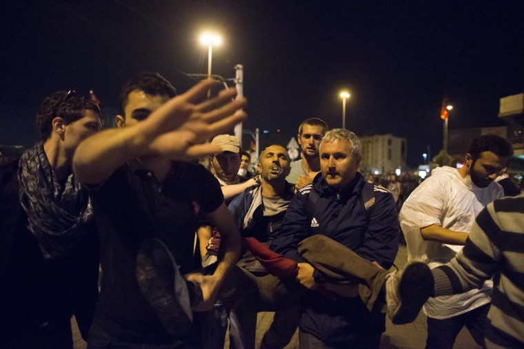A wounded man is taken away during clashes with Turkish police, early morning on June 3, 2013 in Istanbul, Turkey. (Uriel Sinai/Getty Images)
