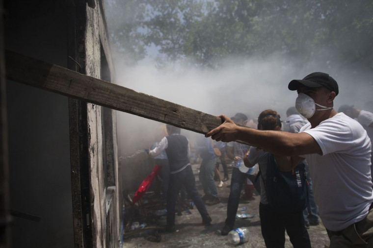 Protestors attempt to put out a fire on June 4, 2013 in Istanbul, Turkey. (Uriel Sinai/Getty Images)
