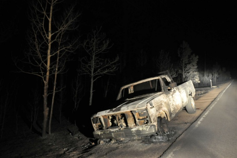 A shell of an automobile destroyed in a fire that's been burning since Tuesday near Colorado Springs sits by the side of the road June 13, 2013 in Black Forest, Colorado. (Tom Cooper/Getty Images)