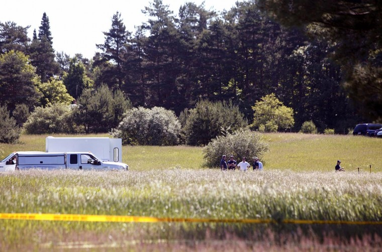 FBI agents search a field outside Detroit for the alleged remains of former Teamsters' union president Jimmy Hoffa June 17, 2013 in Oakland Township, Michigan. The agents were acting on a tip provided by Tony Zerilli, 85, a former mobster, who was released from prison in 2008. Hoffa, who had reported ties to organized crime, went missing in July of 1975. (Bill Pugliano/Getty Images)