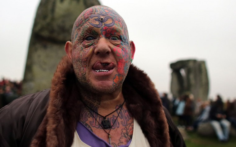 Solstice reveler Mad Al gestures as he joins druids, pagans and others celebrating the summer solstice at the megalithic monument of Stonehenge on June 21, 2013 near Amesbury, England. Despite cloudy skies, thousands of revelers gathered at the 5,000-year old stone circle in Wiltshire to see the sunrise on the Summer Solstice dawn. (Matt Cardy/Getty Images)