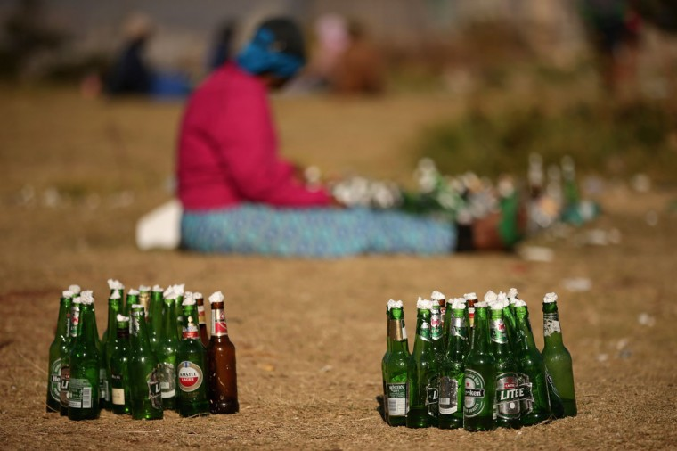 Bottles filled with water and prayers written on paper are lined up before a prayer service of the Indumiso Yamakholwa In Zion church in the Yeoville neighborhood in Johannesburg, South Africa. After being prayed over and blessed, worshipers will smash the bottles to release the prayers to God. The worn, arid space on top of the Yeoville hill offers worshipers of various Christian denominations from South African, Botswana, Zimbabwe, the Democratic Republic of Congo and other African nations an open-air space where they can publicly practice their faith with a scenic view of downtown Johannesburg. (Chip Somodevilla/Getty Images)