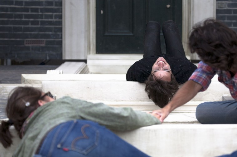 """People interact with a large-scale installation art piece by Leandro Erlich, named """"Dalston House,"""" displayed on June 24, 2013 in London, England. (Dan Dennison/Getty Images)"""