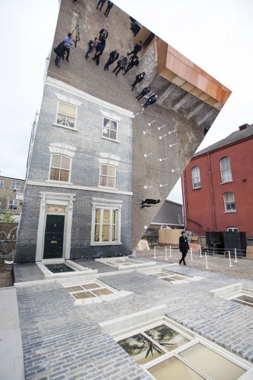 "A large-scale installation art piece by Leandro Erlich, named ""Dalston House,"" is displayed on June 24, 2013 in London, England. (Dan Dennison/Getty Images)"