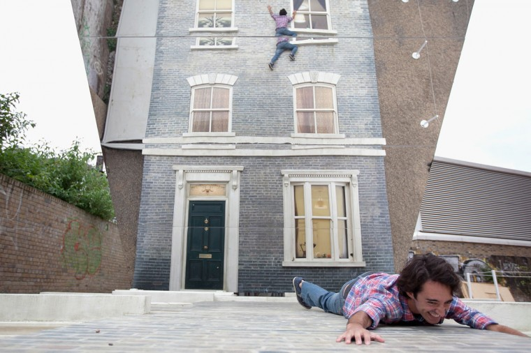 """An man appears in a large-scale installation art piece by Leandro Erlich, named """"Dalston House,"""" on June 24, 2013 in London, England. (Dan Dennison/Getty Images)"""