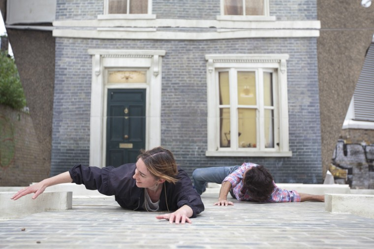 """People appear dangling as a large-scale installation art piece by Leandro Erlich, named """"Dalston House,"""" is displayed on June 24, 2013 in London, England. (Dan Dennison/Getty Images)"""