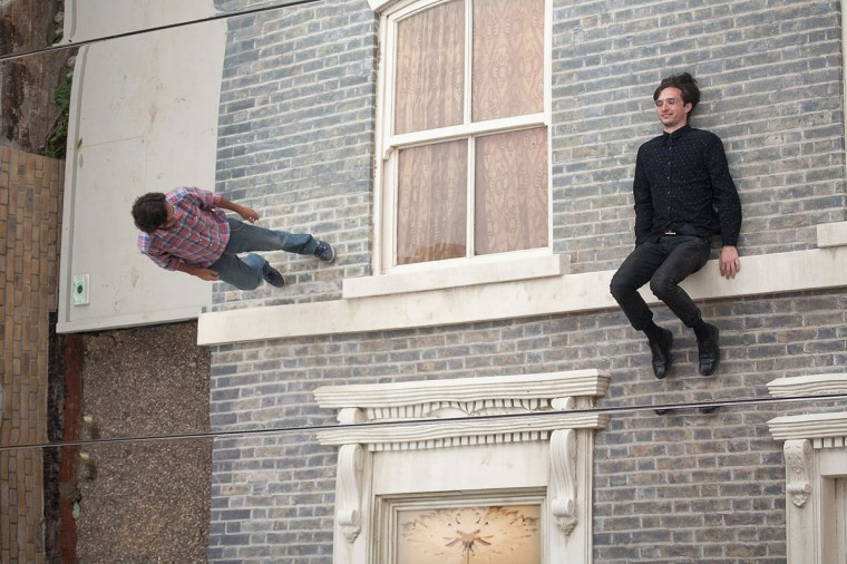 """People interact with a large-scale installation art piece by Leandro Erlich, named """"Dalston House,"""" is displayed on June 24, 2013 in London, England. (Dan Dennison/Getty Images)"""