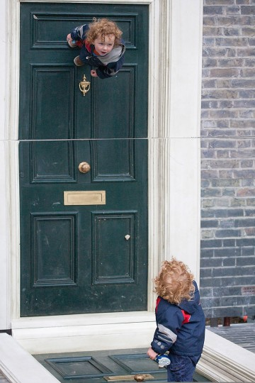 """A child interacts with a large-scale installation art piece by Leandro Erlich, named """"Dalston House,"""" is displayed on June 24, 2013 in London, England. (Dan Dennison/Getty Images)"""
