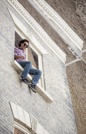 "A person interacts with a large-scale installation art piece by Leandro Erlich, named ""Dalston House,"" is displayed on June 24, 2013 in London, England. (Dan Dennison/Getty Images)"