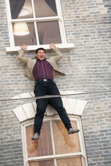 """A person interacts with a large-scale installation art piece by Leandro Erlich, named """"Dalston House,"""" is displayed on June 24, 2013 in London, England. (Dan Dennison/Getty Images)"""
