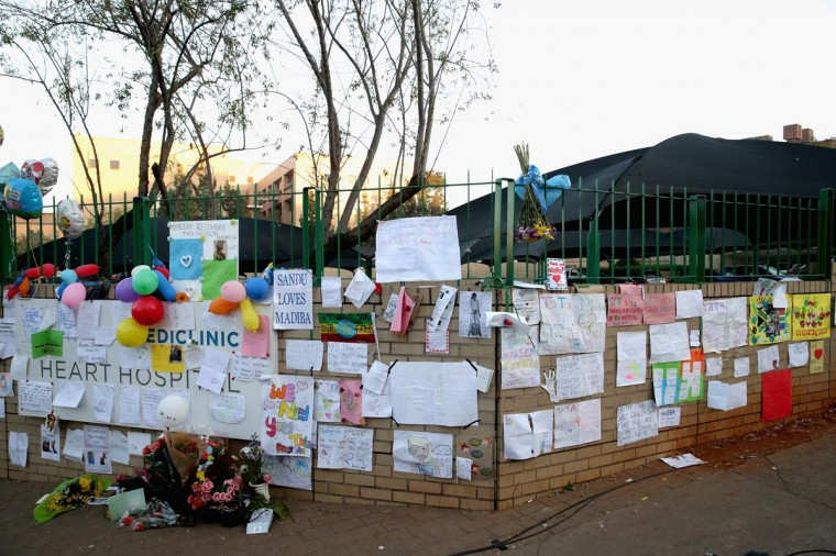Dozens of hand-made messages of support for former South African President Nelson Mandela are posted to the wall outside the Mediclinic Heart Hospital June 25, 2013 in Pretoria, South Africa. (Chip Somodevilla/Getty Images)
