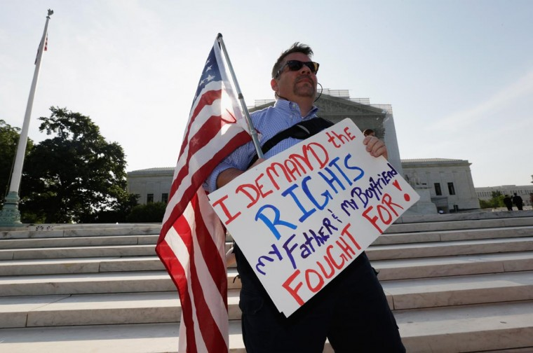 Gay rights supporter Jay Norris, of New York City, holds a U.S. flag outside the U.S. Supreme Court building on June 26, 2013 in Washington, DC. (Win McNamee/Getty Images)