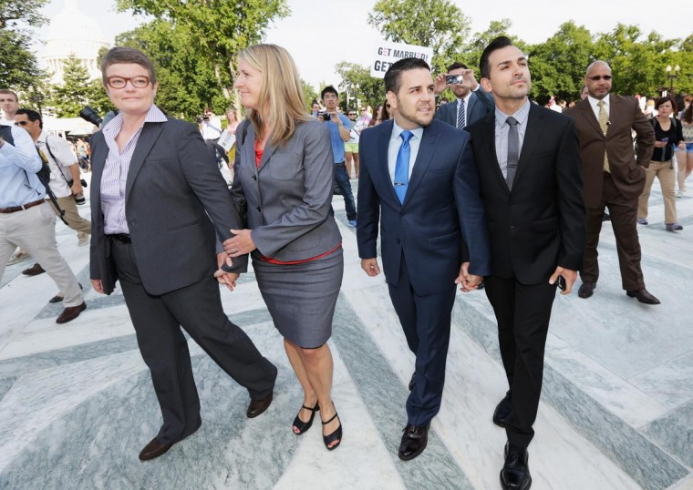 Plaintiff couples Sandy Stier (L) and Kris Perry (2nd L), and Paul Katami (R), and Jeff Zarillo (2nd R) arrive at the U.S. Supreme Court building on June 26, 2013 in Washington, DC. (Win McNamee/Getty Images)