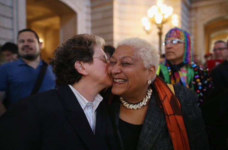 A couple celebrates upon hearing the U.S. Supreme Court has struck down the Defense of Marriage Act at City Hall June 26, 2013 in San Francisco, United States. The high court ruled on DOMA, and will rule on California's Prop 8 as well. (Justin Sullivan/Getty Images)