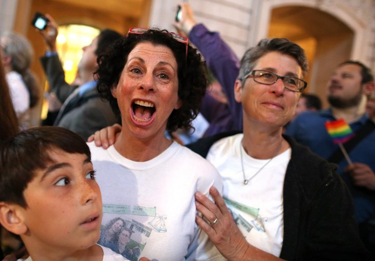 Same-sex couple Sue Rochman (C) and Robin Romdalvik (R) with their son Maddox Rochman-Romdalvik celebrate upon hearing the U.S. Supreme Court's rulings on gay marriage in City Hall June 26, 2013 in San Francisco, United States. (Justin Sullivan/Getty Images)