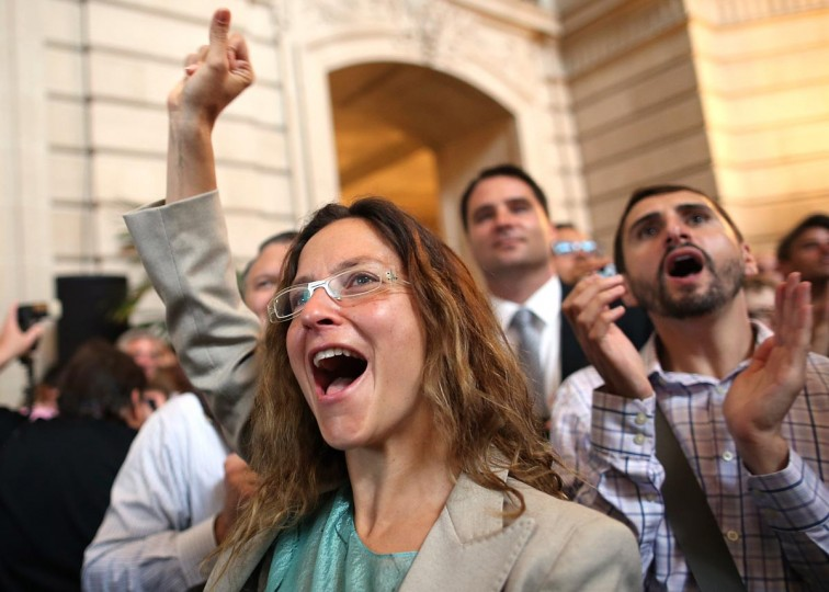 Supporters of same-sex marriage cheer as they learn results of the U.S. Supreme Court's rulings on gay marriage in City Hall June 26, 2013 in San Francisco, United States. (Justin Sullivan/Getty Images)