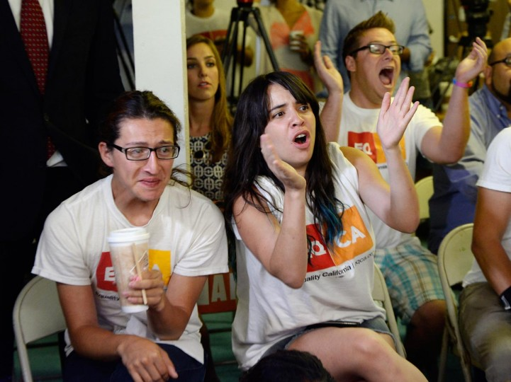 Jesse Quintalla (L), 28, and Jessica Parral, 24, react to the Supreme Court ruling at a watch party at Equality California, a non-profit civil rights organization that advocates for the rights of LGBT people in California, on June 26, 2013 in West Hollywood, California. ( Kevork Djansezian/Getty Images)