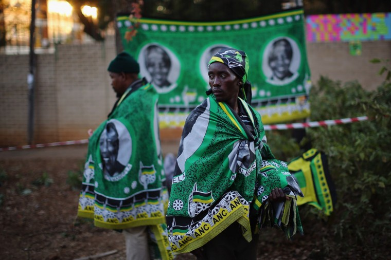 Vendors sell African National Congress flags depicting Nelson Mandela outside the MediClinic Heart hospital where the former South African president is being treated in Pretoria, South Africa. U.S. President Barack Obama met with the former South African leader's family on June 29, 2013, to offer prayers as Mandela continues to be treated for a lung infection. (Dan Kitwood/Getty Images)