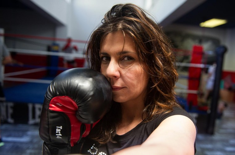 Mari Sol Alcala, a freelance television producer, poses at the Gabriel Campillo boxing gym gym on June 27, 2013 in Madrid, Spain. Spanish women are increasingly taking up the traditional male sport of boxing as a good way to stay in shape. (Denis Doyle/Getty Images)
