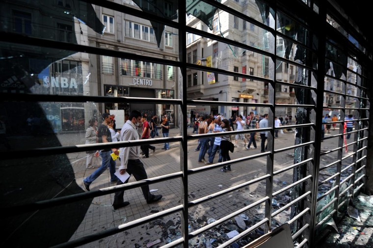 Some stores on Istiklal street are damaged by protestors on June 1, 2013, during a protest against the demolition of Taksim Gezi Park, in Taksim Square in Istanbul. (Ozan Kose/AFP/Getty Images)