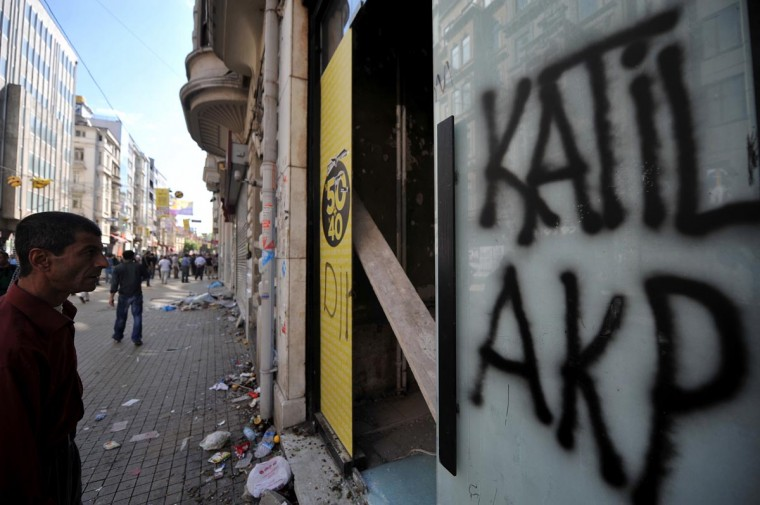 Stores on Istiklal street are damaged by protestors on June 1, 2013, during a protest against the demolition of Taksim Gezi Park, in Taksim Square in Istanbul. (Ozan Kose/AFP/Getty Images)