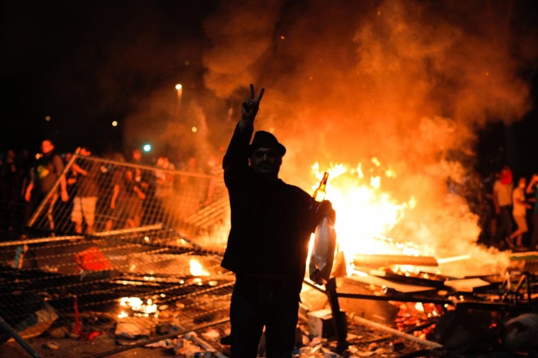 Protestors clash with riot police between Taksim and Besiktas in Istanbul, on June 1, 2013, during a demonstration against the demolition of the park. (Ozan Kose/AFP/Getty Images)