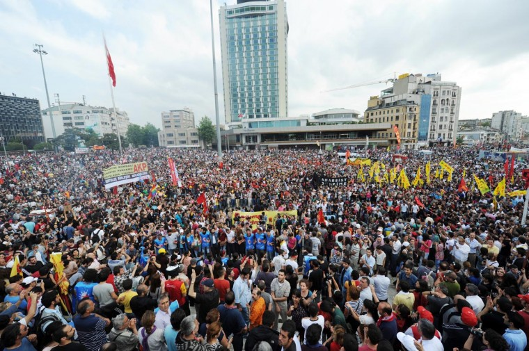 Protestors gather on Taksim square on June 2, 2013, a day after Turkish police pulled out of Istanbul's iconic square following a second day of violent clashes between protesters and police over a controversial development project. (Bulent Kilic/AFP/Getty Images)
