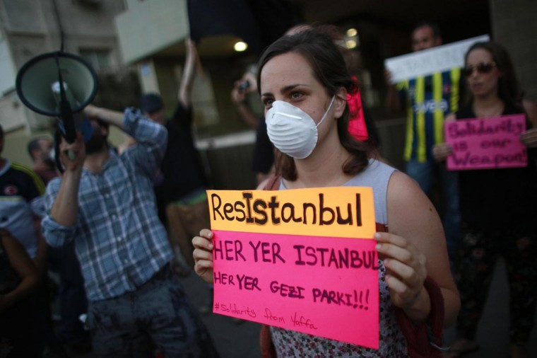 A protester holds a sign as Israelis and Turks demonstrate against the Turkish regime outside the Turkish Embassy in Tel Aviv on June 2, 2013.(Daniel Bar-On/AFP/Getty Images)