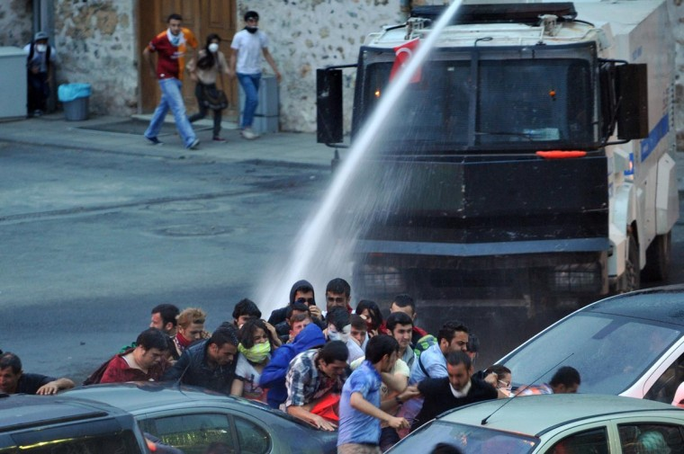 Police use a water cannon to disperse protestors outside Turkish Prime Minister Recep Tayyip Erdogan's working office in Besiktas Istanbul, on June 2, 2013, during a third day of clashes sparked by anger at his Islamist-rooted government. (Ozan Kose/AFP/Getty Images)