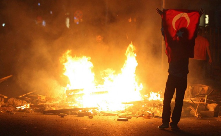A protestor holds a national flag of Turkey during a demonstration in Ankara, early on June 3, 2013, in a nationwide wave of protests. (Adem Altan/AFP/Getty Images)