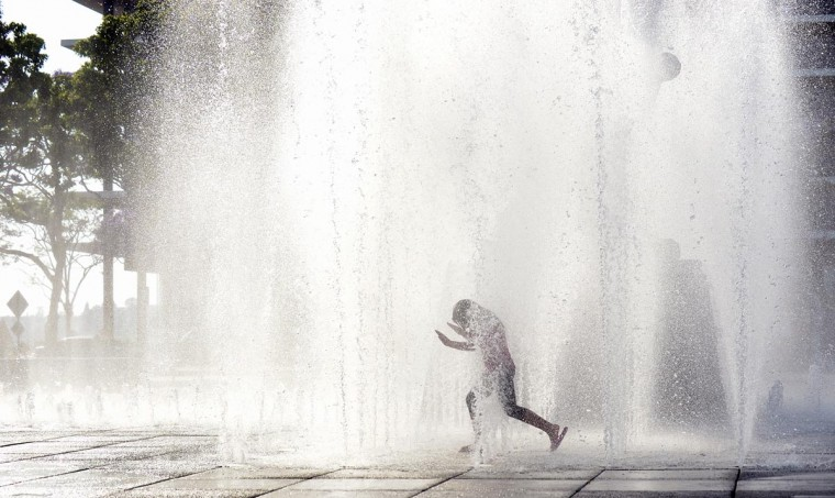 A child cools off in a water fountain plaza at Grand Park in downtown Los Angeles, California, on June 2, 2013, where summer afternoon temperatures reached 75 degrees. (Federic J. Brown/AFP/Getty Images)