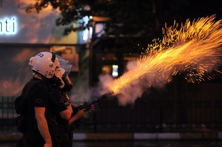 Police tear gas to disperse protestors outside Turkish Prime Minister Recep Tayyip Erdogan's working office in Besiktas Istanbul, on June 2, 2013, during a third day of clashes sparked by anger at his Islamist-rooted government. (Ozan Kose/AFP/Getty Images)