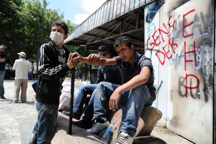 Turkish youths relax in Taksim Gezi park in Istanbul on June 3, 2013 after days of protests against the demolition of the park. (Bulent Kilic/AFP/Getty Images)