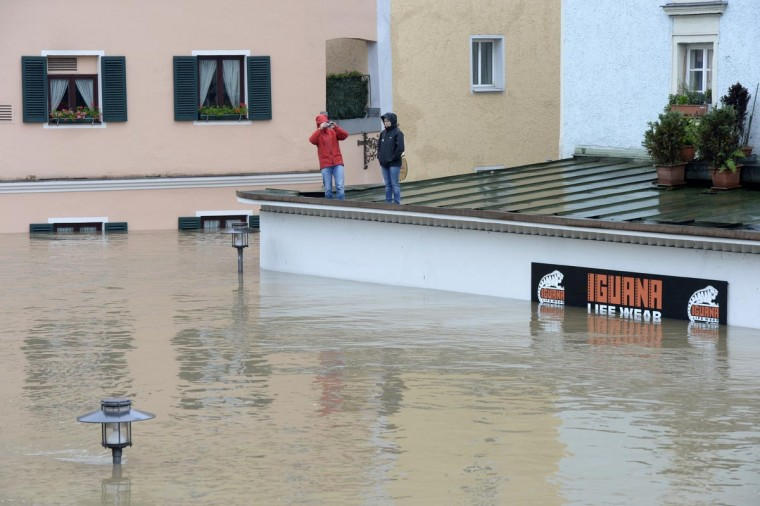 Inhabitants wait for rescuers on the top of a overflooded shop in Passau, Bavaria, on June 3, 2013 as parts of the eastern and southern Germany were flooded due to heavy and ongoing rainfalls. (Christof Stache/AFP/Getty Images)