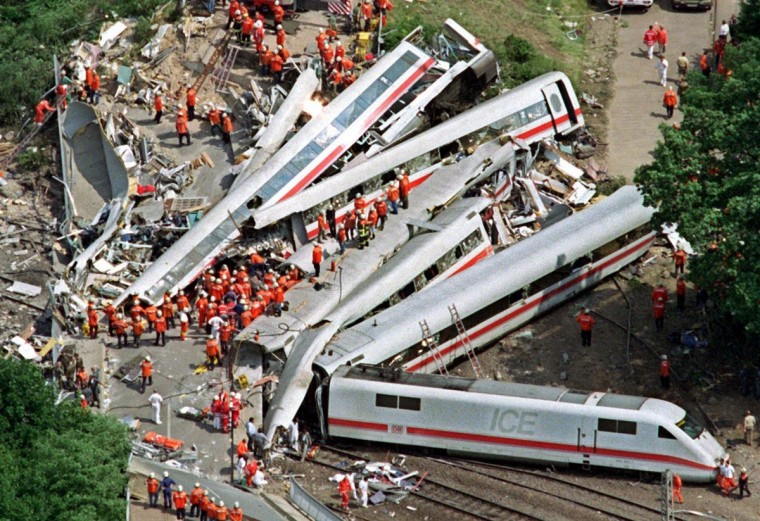 Aerial view taken on June 3, 1998 shows rescue helpers working around the wreckage of the crashed ICE 884 highspeed train near Eschede close to Celle, central Germany. 101 people died in the worst train accident of the country as the Intercity-Express train crashed into a concrete bridge and derailed. (Ingo Wagner/AFP/Getty Images)